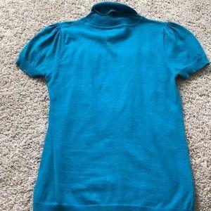 Blue shirt sleeve turtle neck shirt